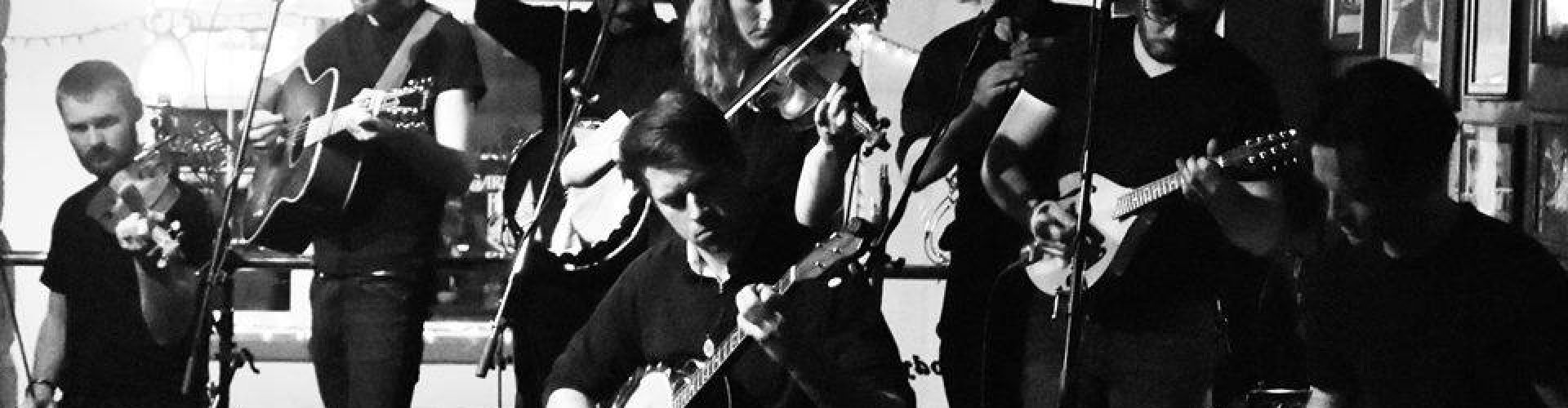 black and white image a band live in action