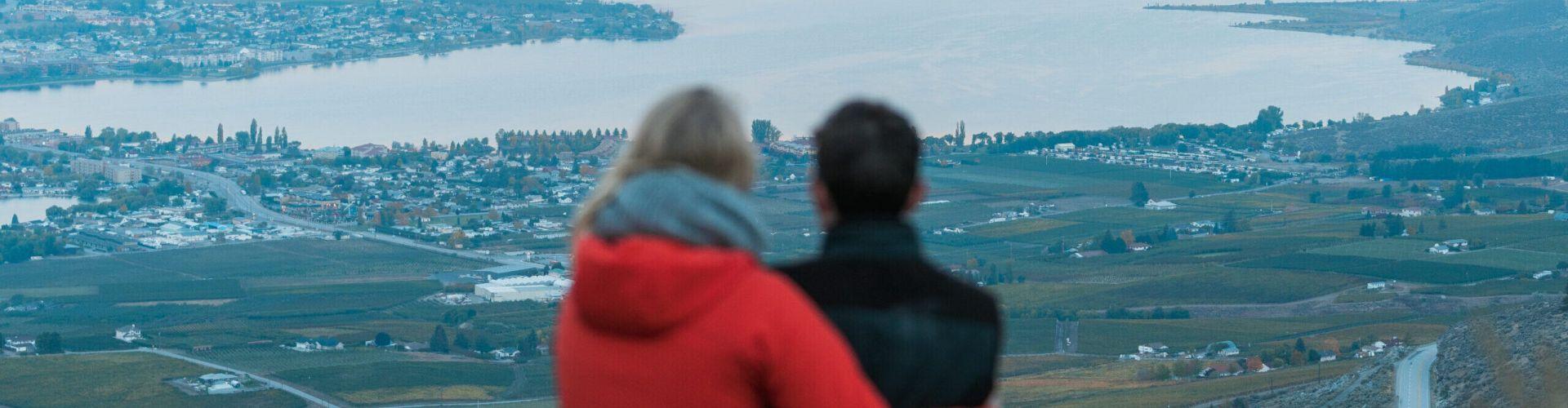Couple standing overlooking Osoyoos